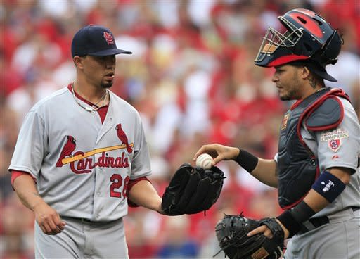 St. Louis Cardinals starting pitcher Kyle Lohse (26) talks with catcher Yadier Molina in the fourth inning of a baseball game against the Cincinnati Reds, Saturday, July 14, 2012, in Cincinnati. (AP Photo/Al Behrman)