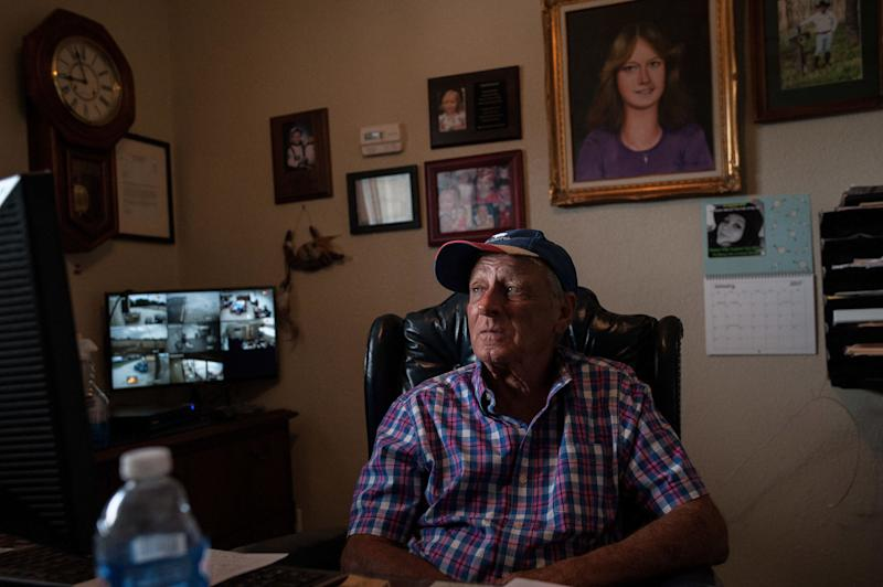 "Tim Miller, founder and director of EquuSearch, sits in his office in front of a portrait of his daughter, Laura, who was abducted and murdered in 1984. Miller founded EquuSearch in 2000 in honor of her. (Photo: <a href=""https://josephrushmore.com/"" target=""_blank"">Joseph Rushmore for HuffPost</a>)"