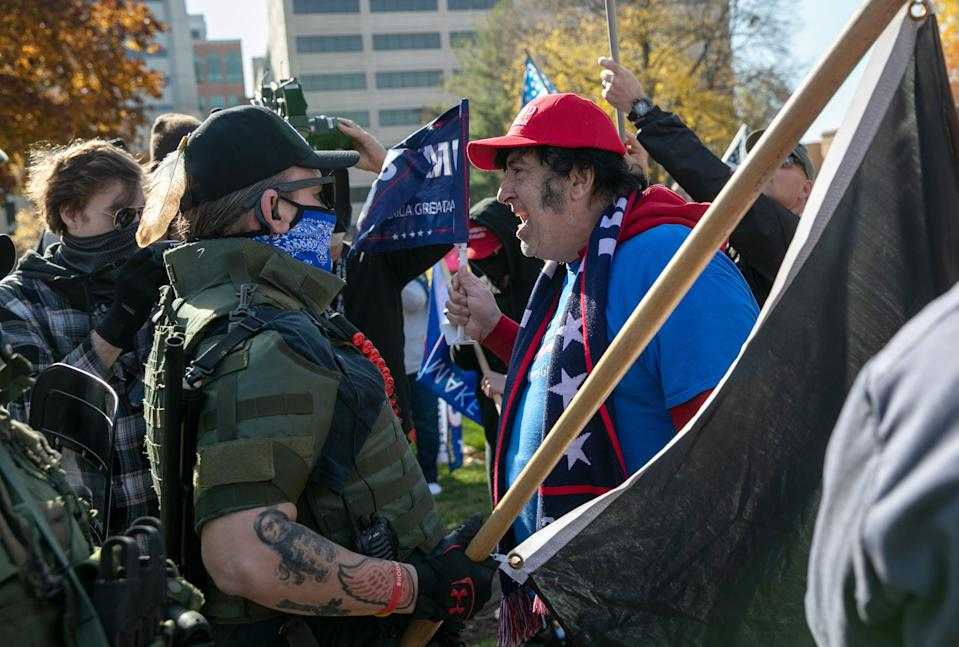 A Trump supporter shouts down counter-protesters during a demonstration over election ballot counting outside the Michigan State Capitol building on November 07, 2020 in Lansing, Michigan.