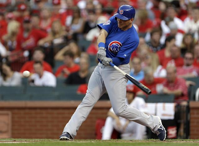 Chicago Cubs' Ryan Sweeney hits a two-run home run during the first inning of a baseball game against the St. Louis Cardinals on Tuesday, June 18, 2013, in St. Louis. (AP Photo/Jeff Roberson)