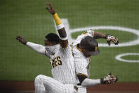 San Diego Padres' Manny Machado, right, is celebrates with teammate Jurickson Profar after hitting a two-run home run during the first inning of a baseball game against the Colorado Rockies, Monday, May 17, 2021, in San Diego. (AP Photo/Denis Poroy)