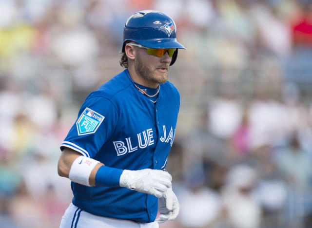 Toronto Blue Jays' Josh Donaldson jogs up the first base line after walking against the Detroit Tigers during third-inning exhibition baseball game action. (AP)