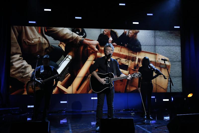 """In this photo provided by NBC, Jon Bon Jovi performs during """"Hurricane Sandy: Coming Together"""" Friday, Nov. 2, 2012, in New York. Hosted by Matt Lauer, the event is heavy on stars identified with New Jersey and the New York metropolitan area, which took the brunt of this week's deadly storm. (AP Photo/NBC, Heidi Gutman)"""
