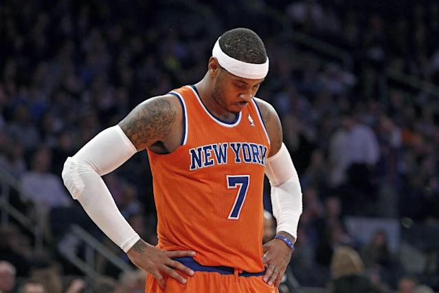 New York Knicks' Carmelo Anthony (7) waits during a break late in the second half action of an NBA basketball game against the Atlanta Hawks Saturday, Nov. 16, 2013, in New York. Atlanta defeated New York 110-90. (AP Photo/Jason DeCrow)