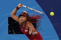 Naomi Osaka, of Japan, plays Marketa Vondrousova, of the Czech Republic, during the third round of the tennis competition at the 2020 Summer Olympics, Tuesday, July 27, 2021, in Tokyo, Japan. (AP Photo/Seth Wenig)