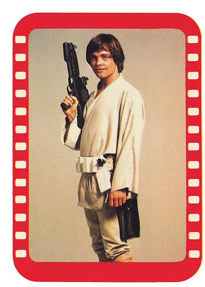 <p>Many of the original images for the earliest Topps lines, such as this shot of a grinning Mark Hamill, came from Lucasfilm's publicity photos — often taken months before or after filming — and were not specific scenes in the films. (Credit: The Topps Company and Lucasfilm Ltd (C) Abrams Books) </p>
