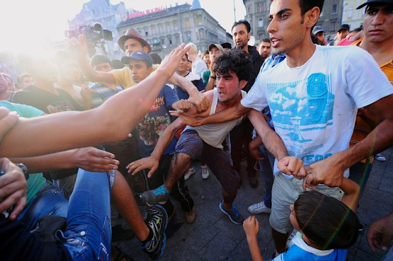 Members of different migrant groups fight in front of the Keleti (East) railway station in Budapest on September 2, 2015