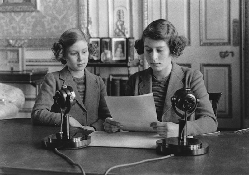 10th October 1940: Princesses Elizabeth and Margaret (1930 - 2002) making a broadcast to the children of the Empire during World War II. (Photo by Topical Press Agency/Getty Images)