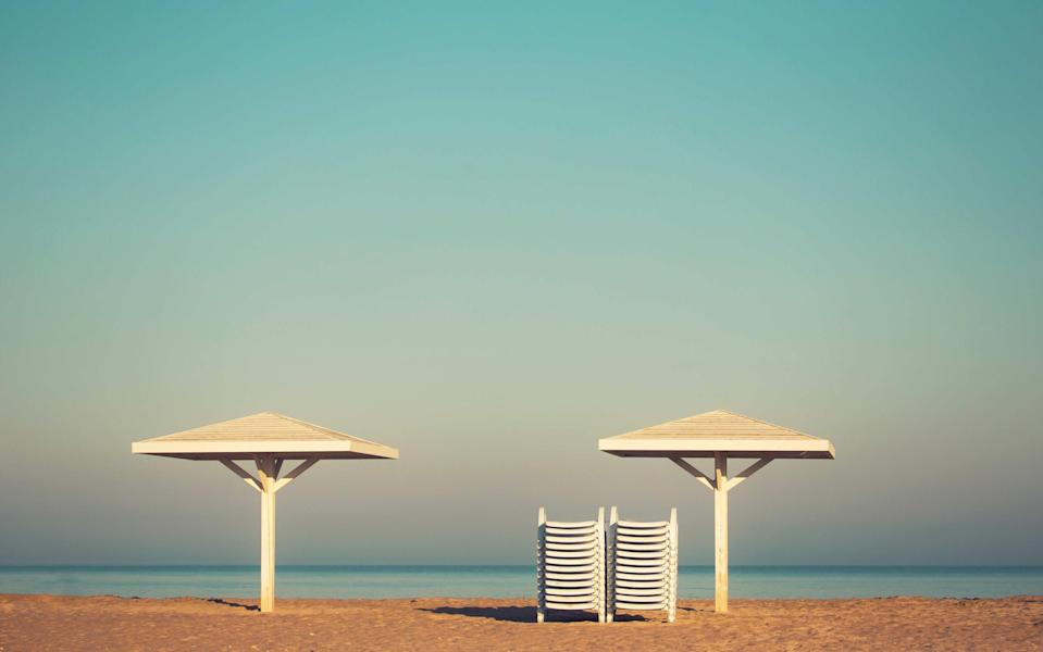 Who decides whether a beach should be empty or full? - istock