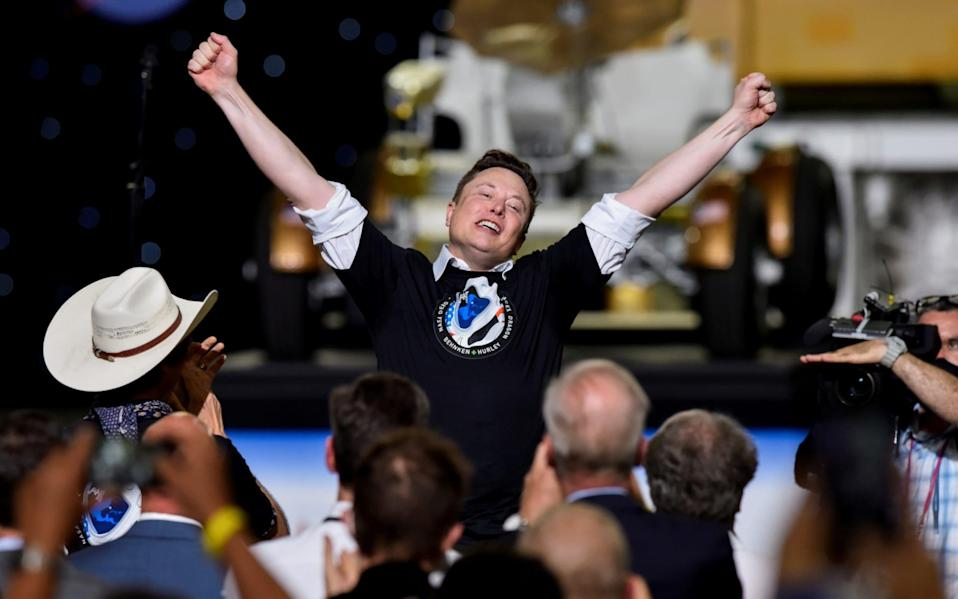 SpaceX CEO and owner Elon Musk celebrates after the launch of a SpaceX Falcon 9 rocket and Crew Dragon spacecraft on NASA's SpaceX Demo-2 mission to the International Space Station from NASA's Kennedy Space Center in Cape Canaveral - Steve Nesius/Reuters