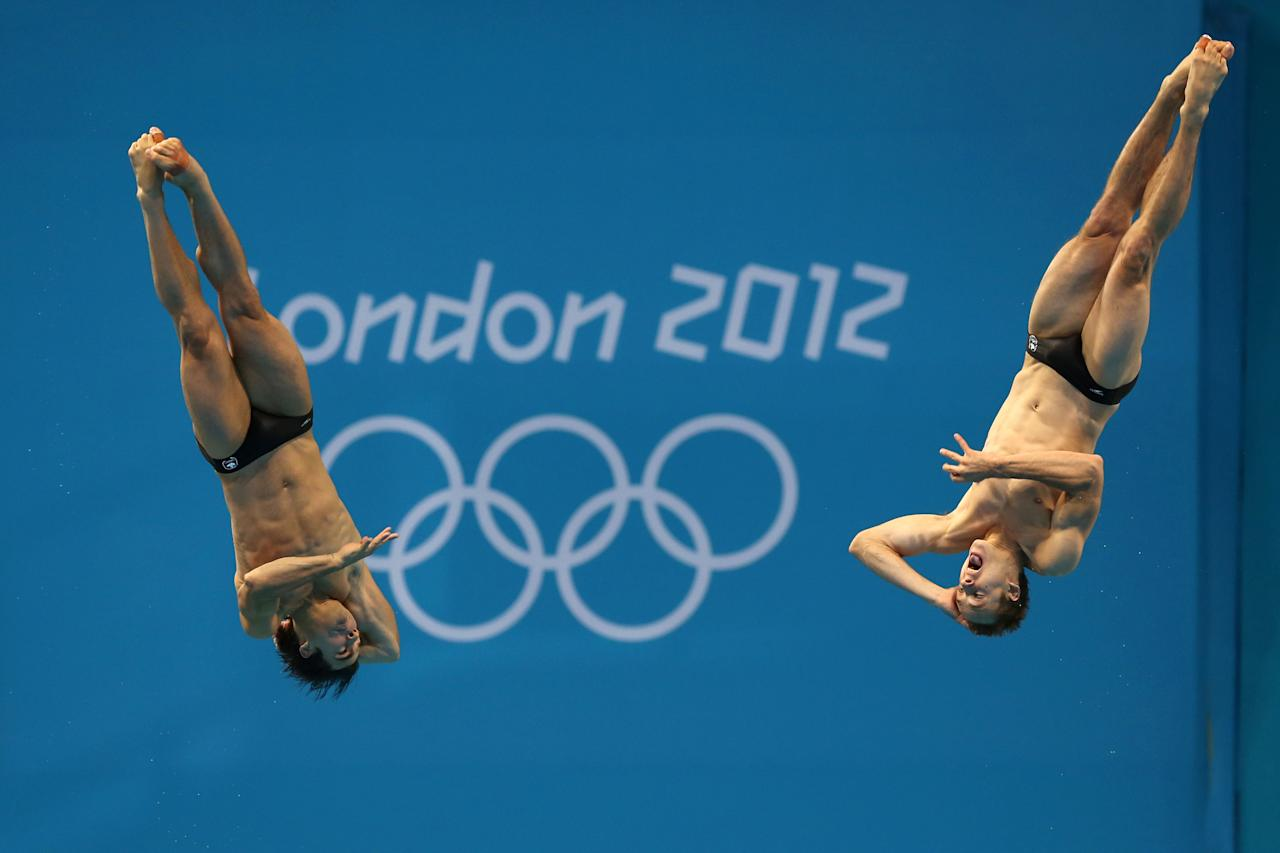 LONDON, ENGLAND - AUGUST 01: Alexandre Despatie and Reuben Ross of Canada compete in the Men's Synchronised 3m Springboard Diving on Day 5 of the London 2012 Olympic Games at the Aquatics Centre on August 1, 2012 in London, England. (Photo by Clive Rose/Getty Images)