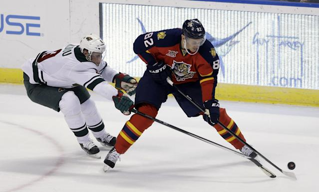 Minnesota Wild's Mikko Koivu (9) battles Flprida Panthers' Tomas Kopecky (82), of Slovakia, for control of the puck in the first period of an NHL hockey game, Saturday, Oct. 19, 2013, in Sunrise, Fla. (AP Photo/Alan Diaz)