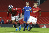 Manchester United's Mason Greenwood, left, scores his side's second goal during the English Premier League soccer match between Manchester United and Brighton and Hove Albion at Old Trafford, Manchester, England, Sunday, Apr. 4, 2021. (Phil Noble/Pool via AP)