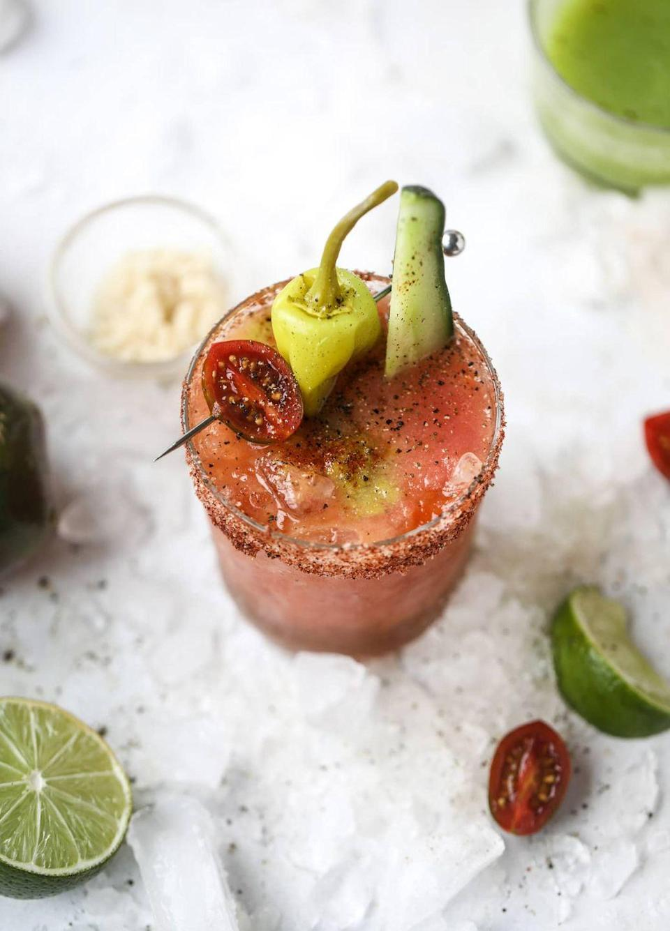 """<p>Your garden's bounty is good for more than mealtime. Use your harvest to give the classic brunch cocktail the ultimate glow up. </p><p>Get the recipe at <a href=""""https://www.howsweeteats.com/2018/08/bloody-mary-recipe/"""" rel=""""nofollow noopener"""" target=""""_blank"""" data-ylk=""""slk:How Sweet Eats"""" class=""""link rapid-noclick-resp"""">How Sweet Eats</a>.</p>"""