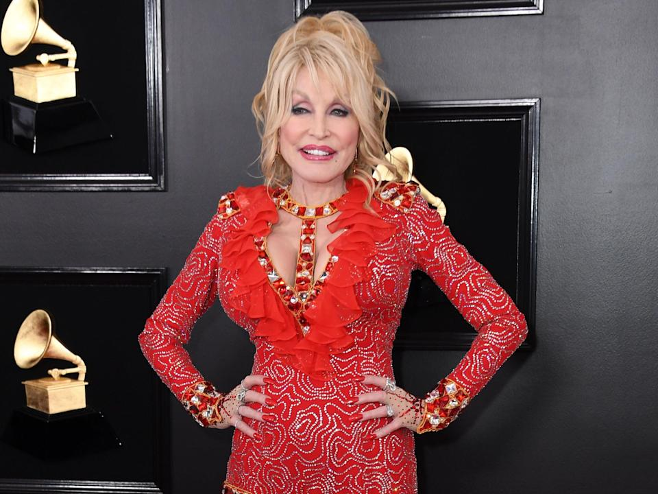 Dolly Parton debunks conspiracy that her husband doesn't exist  (AFP via Getty Images)