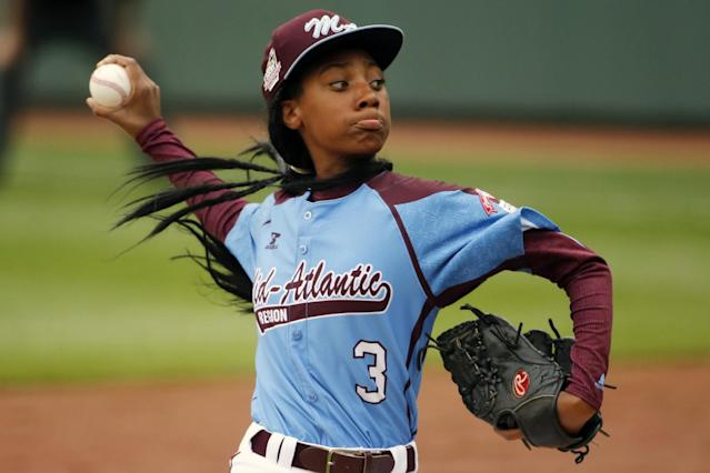Pennsylvania's Mo'ne Davis delivers in the fifth inning against Tennessee during a baseball game in United States pool play at the Little League World Series tournament in South Williamsport, Pa., Friday, Aug. 15, 2014. Pennsylvania won 4-0 with Davis pitching a complete game two-hit shutout. AP Photo/Gene J. Puskar)