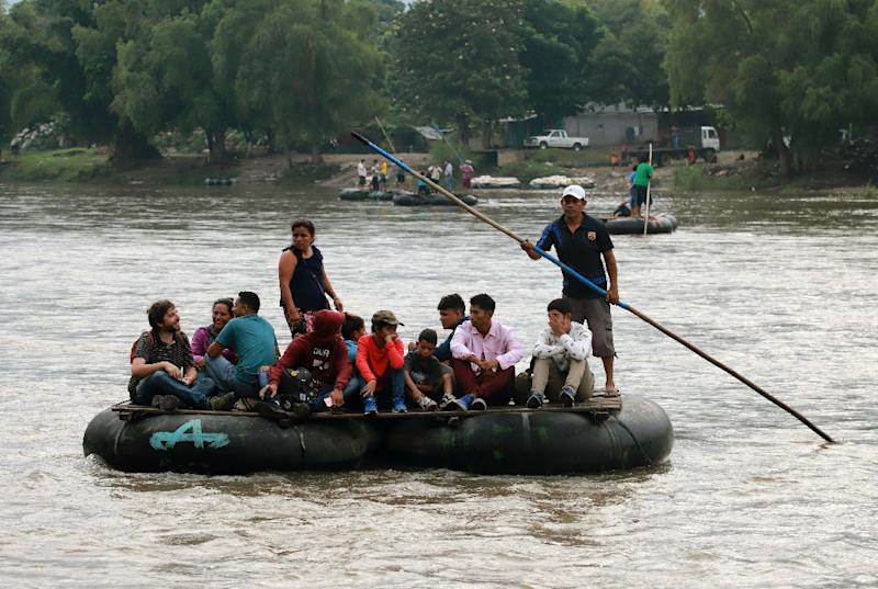 Migrants board rafts to cross the Suchiate river from Guatemala to Mexico, as Mexico races to implement a deal with Washington to curb undocumented migration
