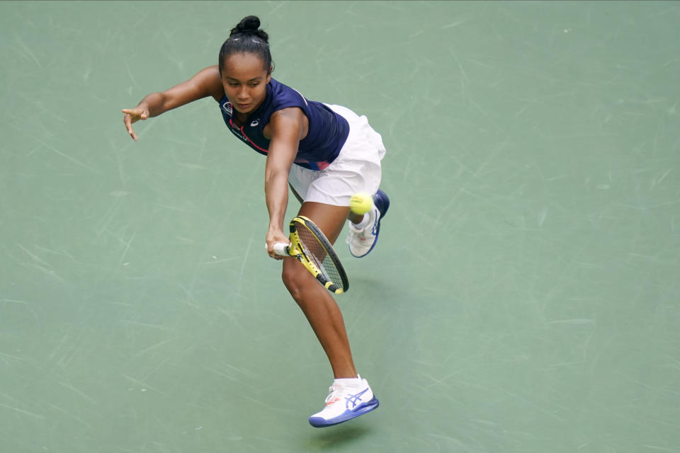Leylah Fernandez, of Canada, returns a shot to Emma Raducanu, of Britain, during the women's singles final of the US Open tennis championships, Saturday, Sept. 11, 2021, in New York. (AP Photo/Frank Franklin II)