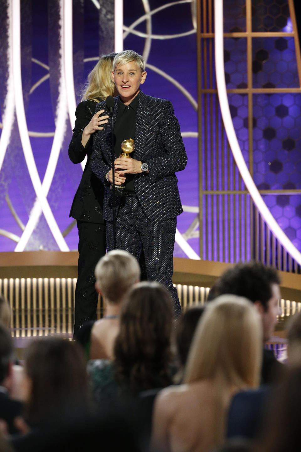 BEVERLY HILLS, CALIFORNIA - JANUARY 05: In this handout photo provided by NBCUniversal Media, LLC,  Ellen DeGeneres accepts the CAROL BURNETT AWARD presented by Kate McKinnon onstage during the 77th Annual Golden Globe Awards at The Beverly Hilton Hotel on January 5, 2020 in Beverly Hills, California. (Photo by Paul Drinkwater/NBCUniversal Media, LLC via Getty Images)
