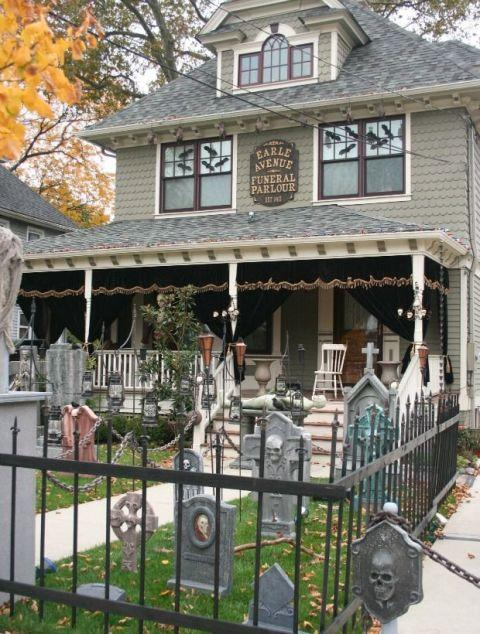 """<p>At this home, trick-or-treaters must brave a DIY graveyard and wraparound porch disguised as an eerie funeral parlor.</p><p><em><a rel=""""nofollow"""" href=""""http://purpleoniondesigns.typepad.com/my_weblog/2010/11/halloween-2010.html"""">Get the tutorial at Purple Onion Designs »</a></em></p><p><strong>What you'll need: </strong><span><span>fake tombstones ($75, <a rel=""""nofollow"""" href=""""https://www.wayfair.com/Design-Toscano-The-Vampire-Demon-Tombstone-Statue-TXG2203.html"""">wayfair.com</a>)</span></span><br></p>"""