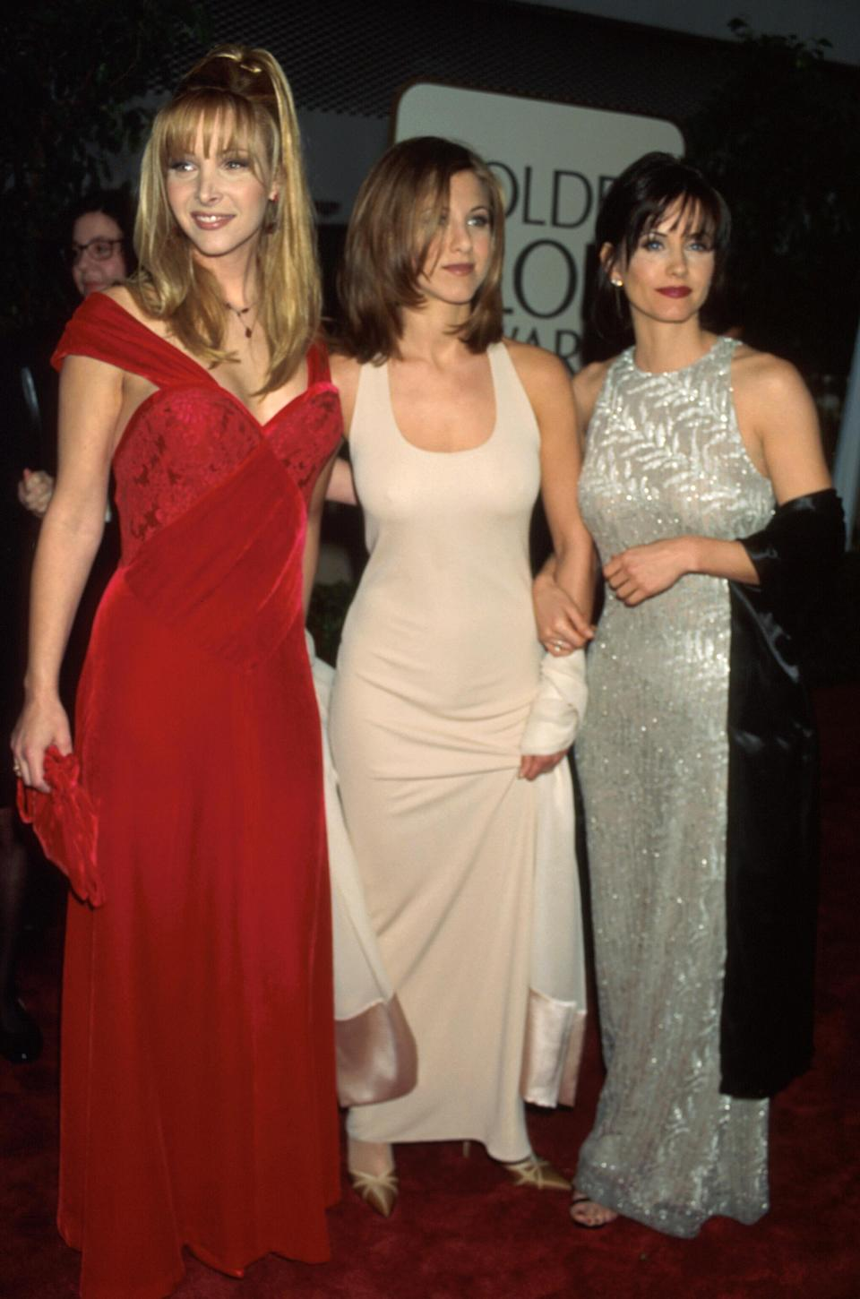 <p>In 1996, Lisa matched the red carpet in an off-the-shoulder gown, while Jennifer worked a neutral, form-fitting look and Courteney went all out in a metallic dress. <em>[Photo: Getty]</em> </p>