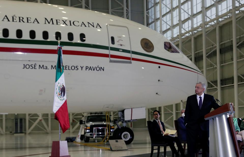 Mexico's President Andres Manuel Lopez Obrador holds a news conference at the presidential hangar, with the presidential plane in the background, at Benito Juarez International Airport in Mexico City, Mexico July 27, 2020. REUTERS/Henry Romero