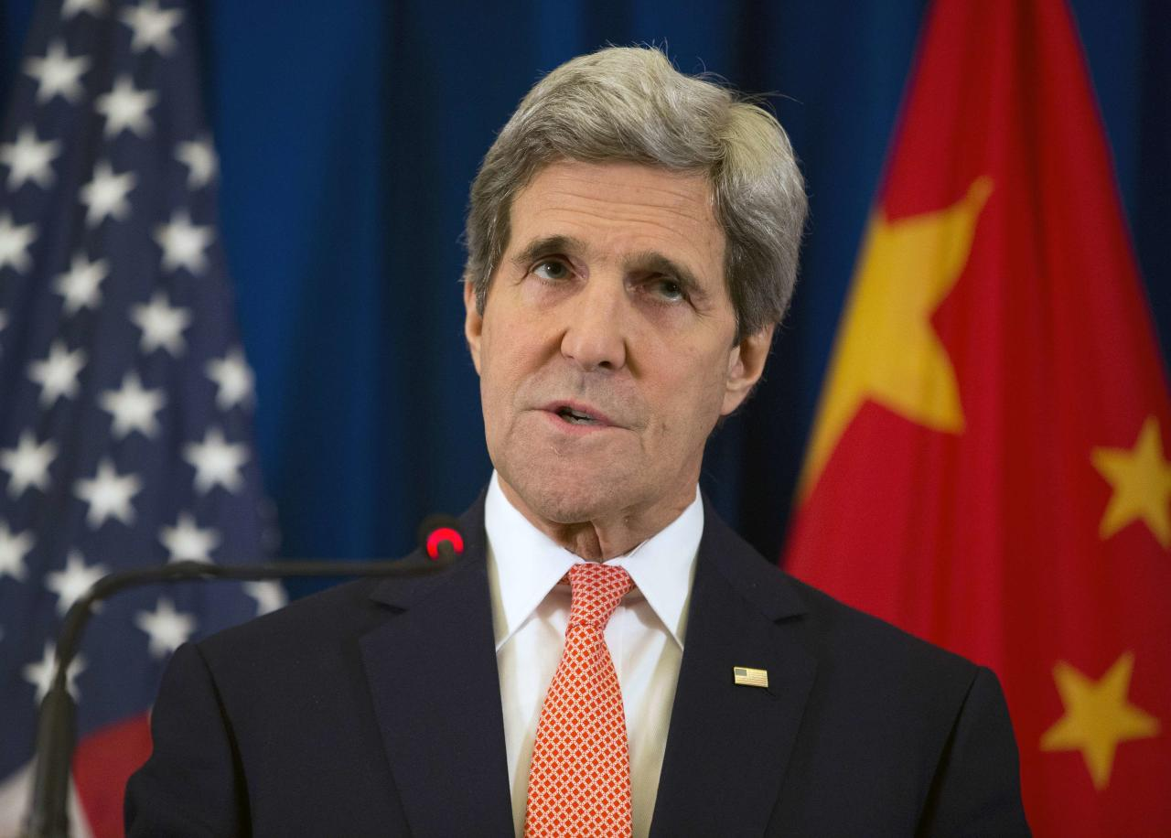 U.S. Secretary of State John Kerry speaks during a news conference in Beijing February 14, 2014. Kerry said on Friday that President Barack Obama has asked for possible new policy options on Syria given the worsening humanitarian situation there. REUTERS/Evan Vucci/Pool (CHINA - Tags: POLITICS)