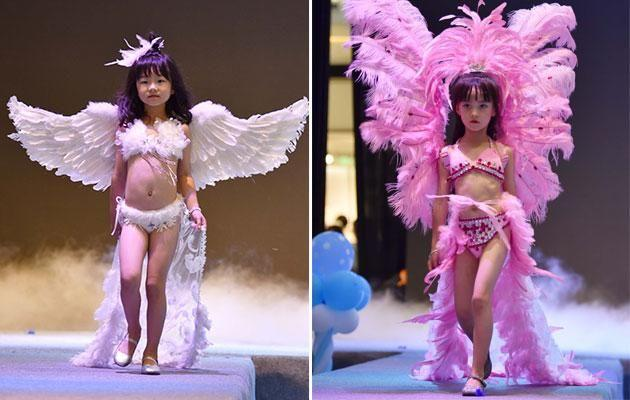 Young girls model lingerie at a fashion show in China. Photo: australscope