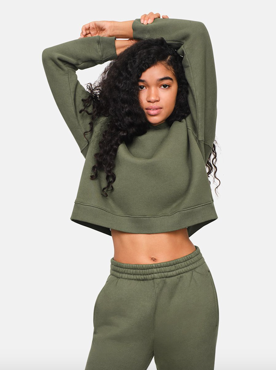 """<h3><strong>Nimbus Cropped Hoodie</strong></h3><br>Any lucky giftee will delight in getting all wrapped up inside the softest (and most stylish) of fleecy snuggles.<br><br><strong>Outdoor Voices</strong> Nimbus Cropped Hoodie, $, available at <a href=""""https://go.skimresources.com/?id=30283X879131&url=https%3A%2F%2Fwww.outdoorvoices.com%2Fproducts%2Fw-Nimbus-Cropped-Hoodie%3Fvariant%3D32645377654862"""" rel=""""nofollow noopener"""" target=""""_blank"""" data-ylk=""""slk:Outdoor Voices"""" class=""""link rapid-noclick-resp"""">Outdoor Voices</a>"""
