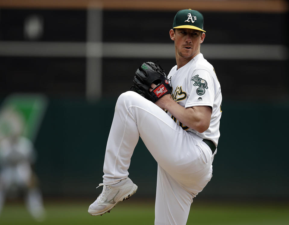 Oakland Athletics pitcher Chris Bassitt works against the Cincinnati Reds in the first inning of a baseball game Thursday, May 9, 2019, in Oakland, Calif. (AP Photo/Ben Margot)