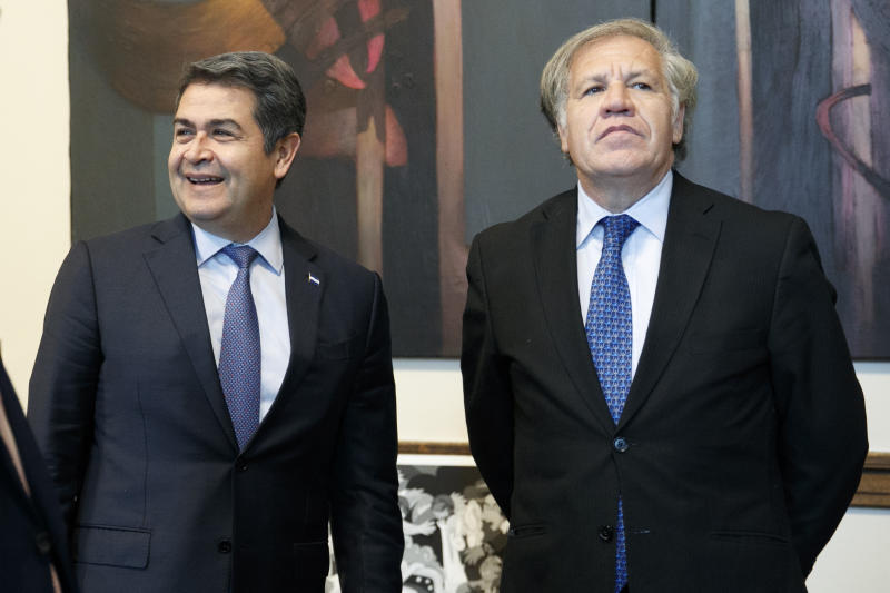Honduran President Juan Orlando Hernandez, left, meets with Organization of American States (OAS) Secretary General Luis Almagro, Tuesday, Aug. 13, 2019, at the Organization of American States, in Washington. (AP Photo/Jacquelyn Martin)