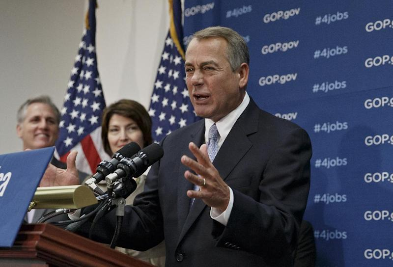 House Speaker John Boehner of Ohio, right, accompanied by House Majority Whip Kevin McCarthy of Calif., left, and Rep. Cathy McMorris Rodgers, R-Wash., speak to reporters about the Keystone XL Pipeline and other issues, following a Republican Conference meeting, Tuesday, Feb. 4, 2014, on Capitol Hill in Washington. (AP Photo/J. Scott Applewhite)