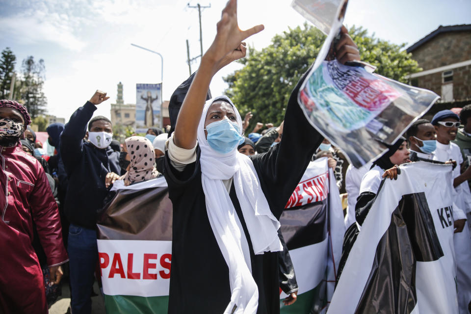 """Demonstrators in Nairobi, Kenya,on Thursday May 13, 2021 rallied to denounce the ongoing crackdown at the Al-Aqsa Mosque compound in Jerusalem's Old City, as well as Israeli plans to forcefully expel Palestinians from their homes in occupied East Jerusalem. Some protesters carried banners reading """"Free Palestine'', (AP Photo/Brian Inganga)"""