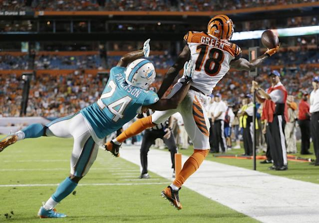 Cincinnati Bengals wide receiver A.J. Green (18) can't hold on to a pass in the end zone as Miami Dolphins cornerback Dimitri Patterson (24) defends during the second half of an NFL football game, Thursday, Oct. 31, 2013, in Miami Gardens, Fla. (AP Photo/Wilfredo Lee)