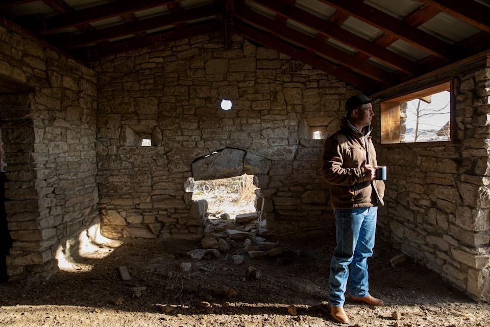 Elias Eiguren walks through a historic fort building that stands on the family's property near Arock, Oregon, on March 27. (Photo: Kristina Barker for HuffPost)