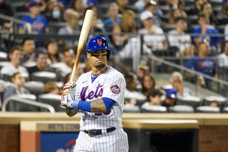 New York Mets' Javier Baez reacts after striking out in the fourth inning of the baseball game against the Cincinnati Reds, Saturday, July 31, 2021, in New York. (AP Photo/Mary Altaffer)