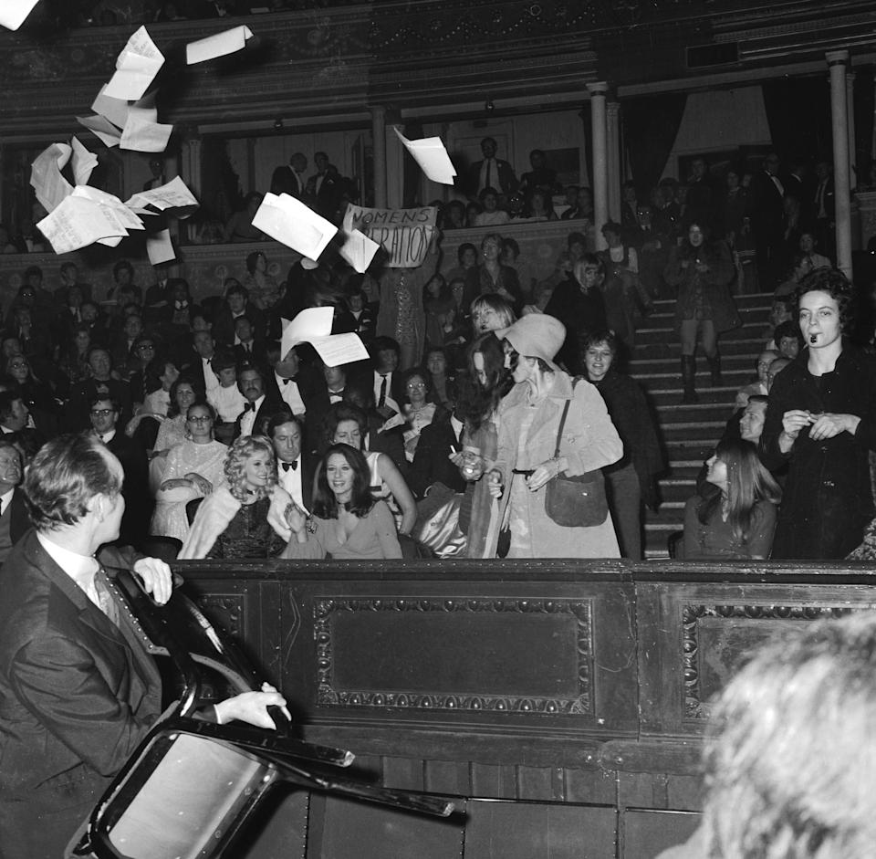 21st November 1970:  The Miss World contest causes a feminist storm as demonstrators invade the Royal Albert Hall where the contest was held. Protestors fired ink at spectators and let off stink bombs in scenes resembling a school assembly. The unruly ladies were eventually expelled from the hall by security guards and policemen.  (Photo by Leonard Burt/Central Press/Getty Images)