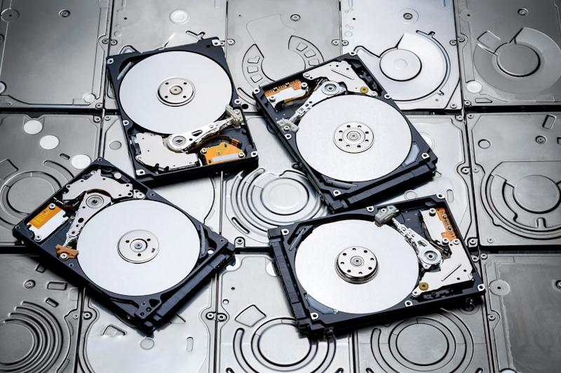 Four overturned HDDs placed atop other HDDs.