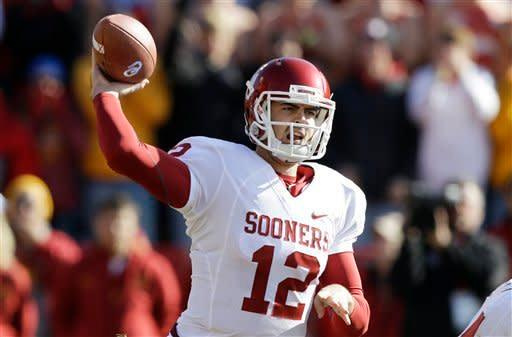 Oklahoma quarterback Landry Jones throws a pass during the first half of an NCAA college football game against Iowa State, Saturday, Nov. 3, 2012, in Ames, Iowa. (AP Photo/Charlie Neibergall)