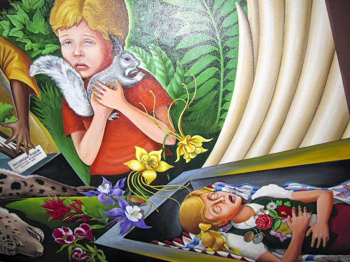 """Sections of Leo Tanguma's """"In Peace and Harmony with Nature"""" murals at the Denver International Airport."""