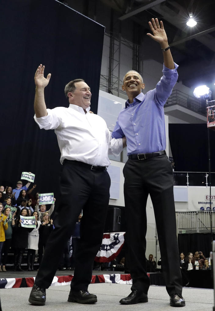 CORRECTS TO SAY THAT DONNELLY IS A CONGRESSIONAL CANDIDATE, NOT A GUBERNATORIAL CANDIDATE - Former President Barack Obama, right, and Democratic congressional candidate U.S. Sen. Joe Donnelly smile as they wave to the crowd during a campaign rally at Genesis Convention Center in Gary, Ind., Sunday, Nov. 4, 2018. (AP Photo/Nam Y. Huh)