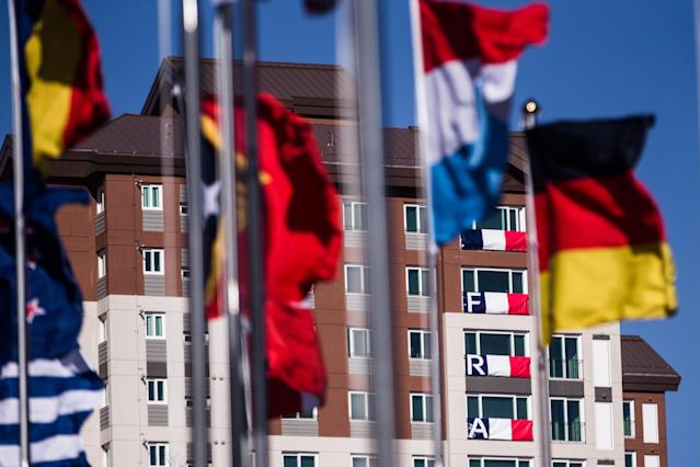 <p>The national flags hoisted in the Olympic Village ahead of the 2018 Winter Olympic Games. (Sergei Bobylev\TASS via Getty Images) </p>