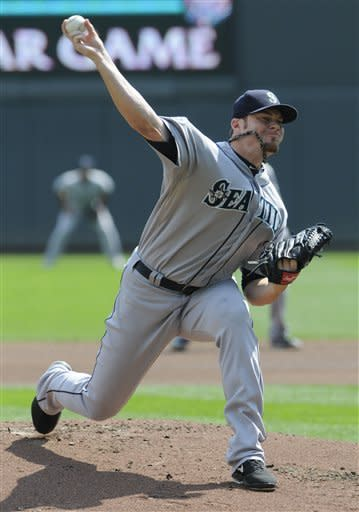 Seattle Mariners pitcher Blake Beavan throws against the Minnesota Twins during the first inning of a baseball game, Thursday, Aug. 30, 2012, in Minneapolis. (AP Photo/Jim Mone)