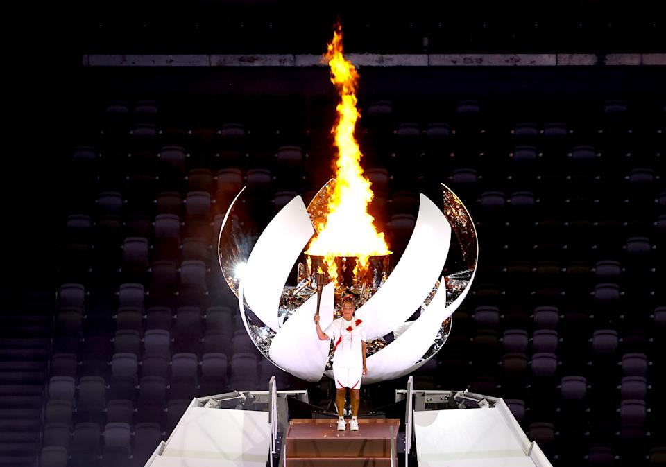 <p>TOKYO, JAPAN - JULY 23: Naomi Osaka of Team Japan lights the Olympic cauldron with the Olympic torch during the Opening Ceremony of the Tokyo 2020 Olympic Games at Olympic Stadium on July 23, 2021 in Tokyo, Japan. (Photo by Laurence Griffiths/Getty Images)</p>