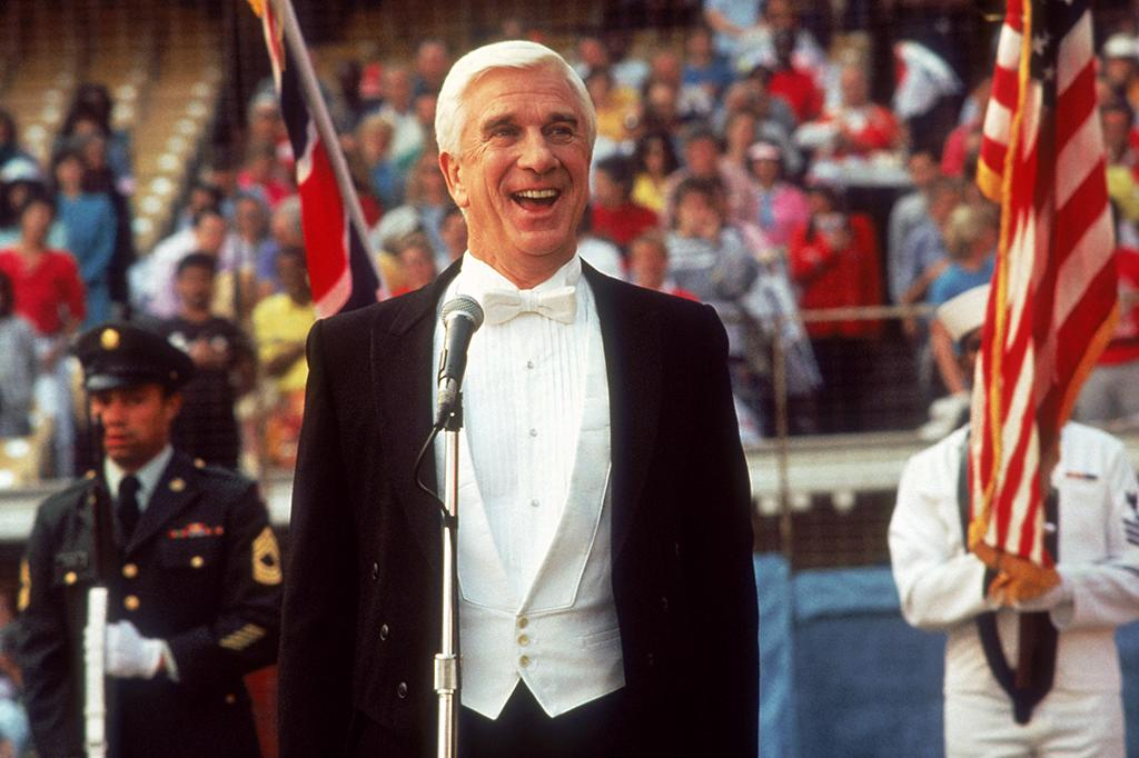 """<b>Umpire/National Anthem Singer: Lt. Frank Drebin/Enrico Palazzo</b> (Leslie Nielsen) in """"The Naked Gun: From the Files of Police Squad!"""" (1988) -- He doesn't have the best eyes in the game, and his strike zone is a bit rubbery, but boy can he sing."""