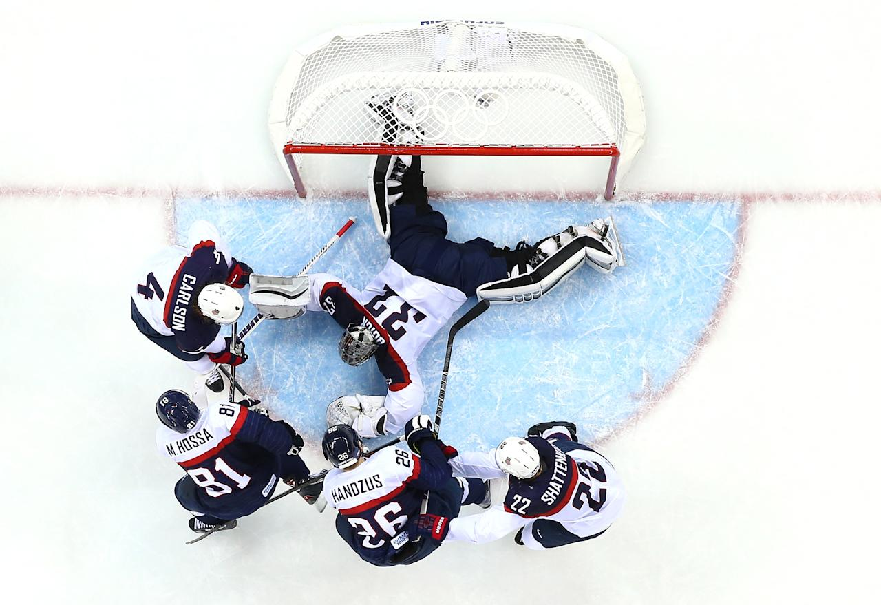 SOCHI, RUSSIA - FEBRUARY 13: Jonathan Quick #32 of United States attempts to save a goal against Slovakia during the Men's Ice Hockey Preliminary Round Group A game on day six of the Sochi 2014 Winter Olympics at Shayba Arena on February 13, 2014 in Sochi, Russia. (Photo by Streeter Lecka/Getty Images)