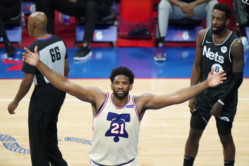 Philadelphia 76ers' Joel Embiid (21) celebrates after scoring during the second half of an NBA basketball game against the Brooklyn Nets, Wednesday, April 14, 2021, in Philadelphia. (AP Photo/Matt Slocum)