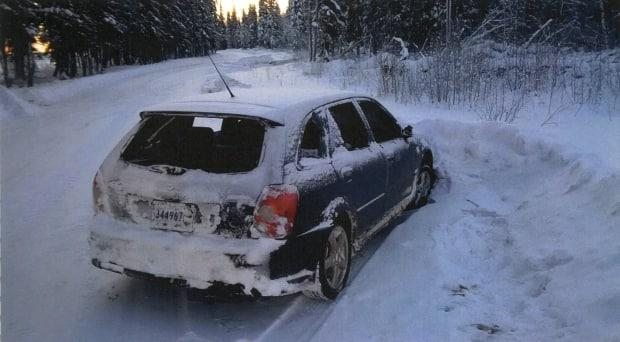 A photo exhibit entered during the trial of James George Thomas shows the Mazda Protege, with broken windows, in which the victim of a Hay River robbery and beating was found more than a day after the attack. (Public Prosecution Service of Canada - image credit)
