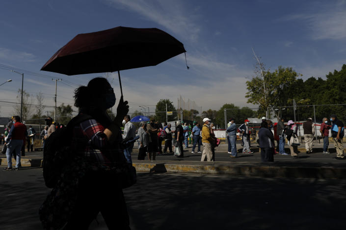 Residents of the Iztacalco borough follow a long, snaking line to receive doses of the Russian COVID-19 vaccine Sputnik V, during a mass vaccination campaign for Mexicans over age 60, at the Advanced School for Physical Education, in Mexico City, Wednesday, Feb. 24, 2021. (AP Photo/Rebecca Blackwell)