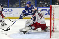 Columbus Blue Jackets goaltender Elvis Merzlikins makes a save against Tampa Bay Lightning's Ondrej Palat during the second period of an NHL hockey game Thursday, April 22, 2021, in Tampa, Fla. (AP Photo/Mike Carlson)